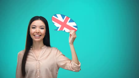 pronunciation : Smiling girl holding British flag speech bubble, learning language, travel ideas