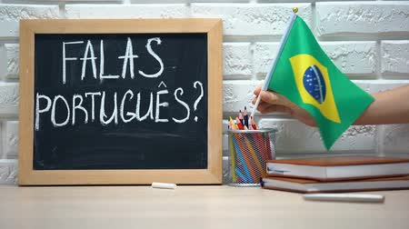 brezilya : Do you speak Portuguese text on board, hand putting Brazil flag in box, language