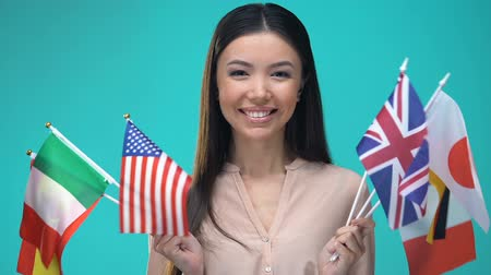 foreign national : Young asian lady holding national flags hands, international friendship, union