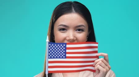 visa : Woman covering mouth by American flag, national symbol, tourism and migration