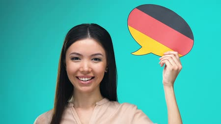 foreign national : Beautiful woman holding German speech bubble, foreign language courses, travel