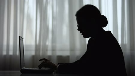 ekstra : Tired business woman silhouette taking off glasses and closing laptop, overwork Stok Video