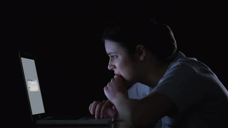 download : Nervous woman waiting for files downloading or upgrading of software on laptop