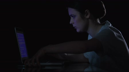 download : Woman watching at blue screen of death on her laptop and calling to master
