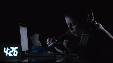 tosse : Sick lady pouring syrup sitting at computer at night, suffering flu symptoms Stock Footage