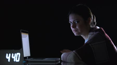 emek : Crying woman working on laptop and showing help sign, hard labor conditions