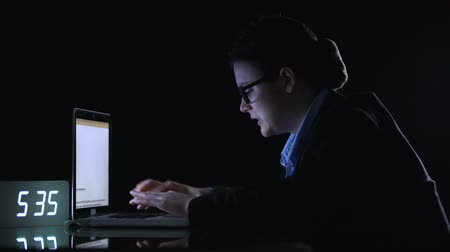 businesslady : Lady assistant typing on computer preparing research for boss, night overworking Stock Footage