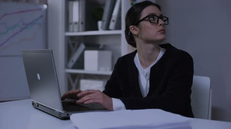 отчаянный : Female secretary feeling desperate, looking at pile of documents, bookkeeping Стоковые видеозаписи