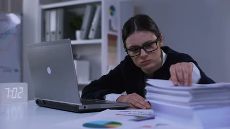 rozsáhlý : Depressed financial expert looking through pile of documents, feeling miserable