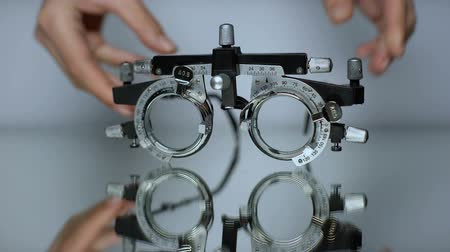 оптический : Hands putting special glasses for vision check, diagnosis of eye diseases