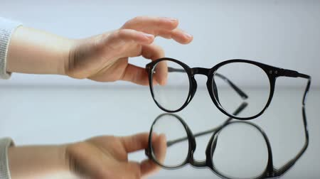 corrections : Child hand taking spectacles, diagnosis of kid eyesight, ophthalmology help Stock Footage