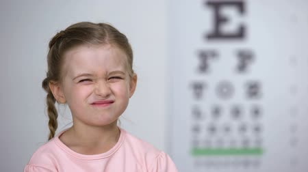 оптический : Female child with poor eyesight happy to wear comfortable eyeglasses, smile Стоковые видеозаписи