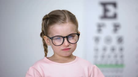оптический : Crying girl taking off glasses, worrying about bullying from peers, insecurities