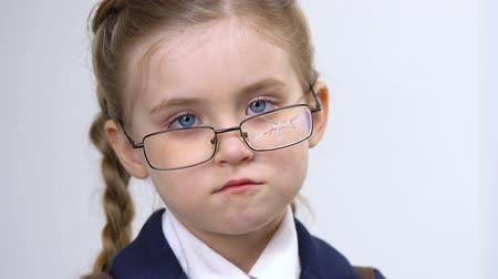 insecurities : Upset girl in broken glasses looking at camera closeup, school bullying, abuse Stock Footage