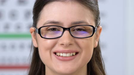 recommandation : Woman in eyeglasses smiling at camera, ophthalmological problems treatment