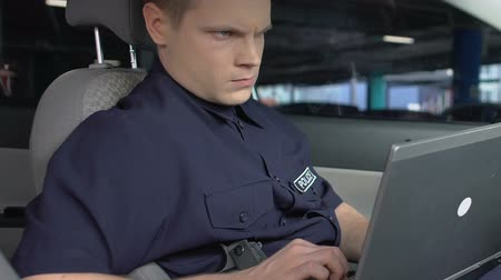 patrolman : Attentive cop monitoring road conditions and traffic jams, laptop online app