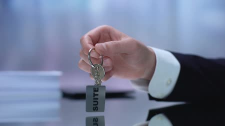 yazılı : Hand demonstrating keys from suite, luxurious condominium, real estate