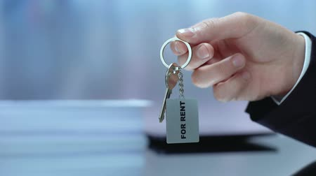 inchecken : Hand holding keychain, real estate business, housing for rent, construction