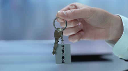 residencial : For sale written on keychain businessman demonstrating, real estate, purchase