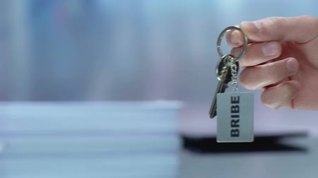 official : Bribe written on keychain female taking, corrupted governmental system, crime Stock Footage