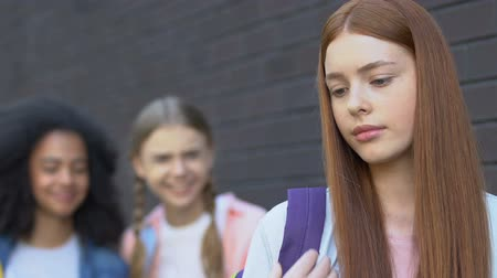 taunting : Schoolgirls laughing at insecure female classmate, mocking red hair, bullying