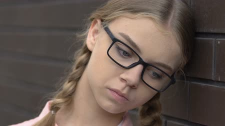 разочарование : Upset teen girl feeling bored and depressed, lack of friends, introvert closeup Стоковые видеозаписи