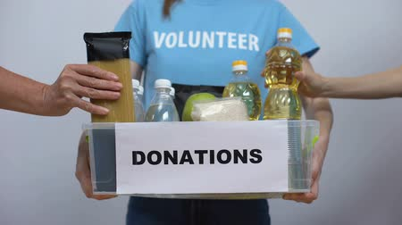 voluntary : Hands putting food staff donation box, volunteer provision project charity event