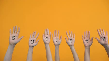 voluntário : Society written palms on orange background, teamwork togetherness, support
