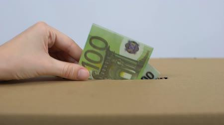 pudełko : Female hand putting euro banknote in donation box, charity foundation, altruism