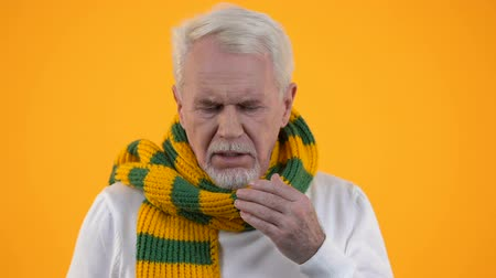 pacjent : Coughing mature man scarf suffering sore throat, health care, influenza symptom