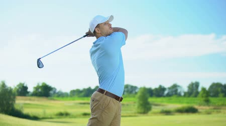 cursos : Pleased man performing swing hitting golf ball, successful shot, sport victory