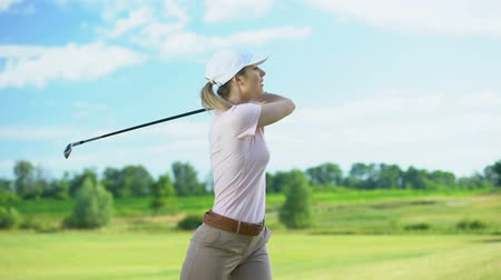 seçkinler : Beginner female golf player with club hitting ball, rejoicing shot, victory Stok Video