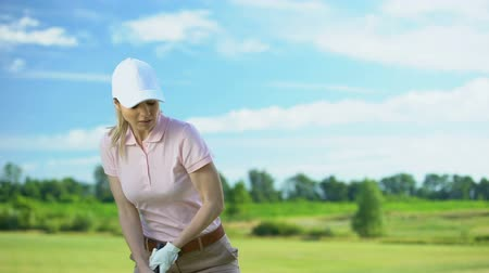敗者 : Woman playing golf in backswing position, upset about failed shot, loser concept