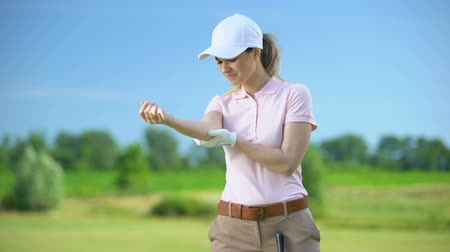 ortopedia : Female golfer in sportswear massaging painful elbow after sports trauma, health