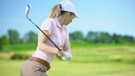elite : Athletic woman playing golf, feeling terrible spasm in back, sports trauma Stock Footage