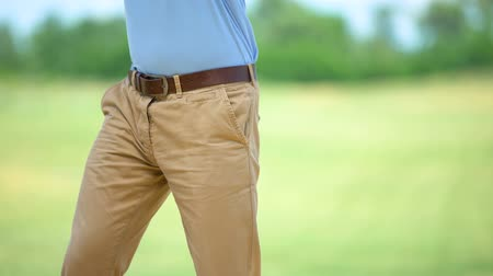 masaj : Man playing golf, suddenly feeling sharp elbow pain, massaging to relieve spasm