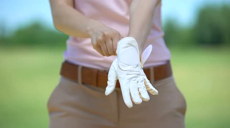 regulamin : Slim female golfer using white glove, qualitative sports equipment, luxury hobby Wideo