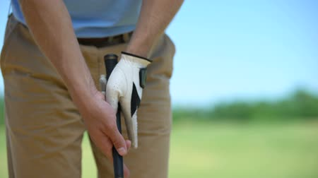 elite : Experienced man golf player in white glove holding iron club ready to sport game