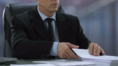 official : Senior male manager working on documents, reading contract details, politician Stock Footage