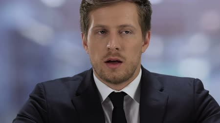 прокат : Stressed young man in suit feeling nervous during job interview, employment