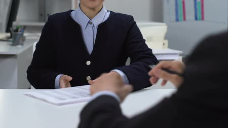 statistic : Male director signing documents and giving to female assistant, office work Stock Footage