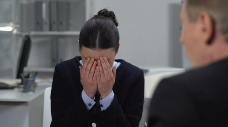 dokumentum : Crying female employee suffering work stress, mad boss shouting at assistant Stock mozgókép