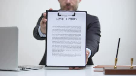 dokumentum : Attorney showing divorce policy, division of property and custody, family law Stock mozgókép