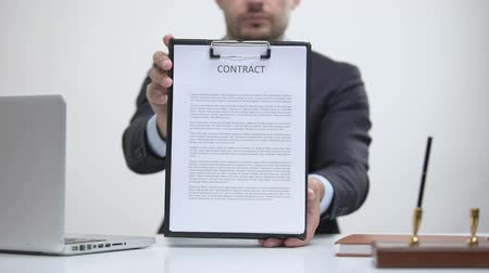 konsultant : Business lawyer holding contract, notary service of sale and purchase agreements