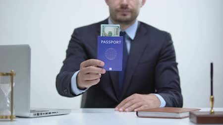 official : Migrant officer holding passport with dollars, payment for id card services Stock Footage