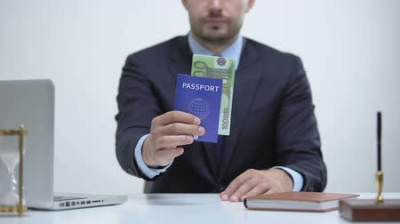 official : Officer holding passport with euros, payment for id card services, migration Stock Footage
