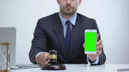 digital code : Attorney banging gavel holding cellphone, constitutional law in mobile apps