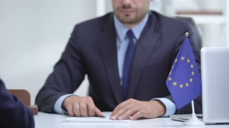 official : Politician of European Union signing sanction termination, congratulates partner Stock Footage