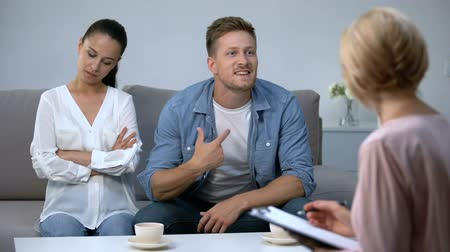 nervous : Nervous man blaming wife at psychologist reception, risk of divorce, problem Stock Footage