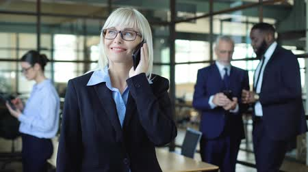 tariff : Happy pretty manager talking on phone, business mobile tariff, communication